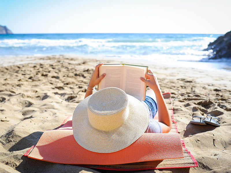 lady reading on beach