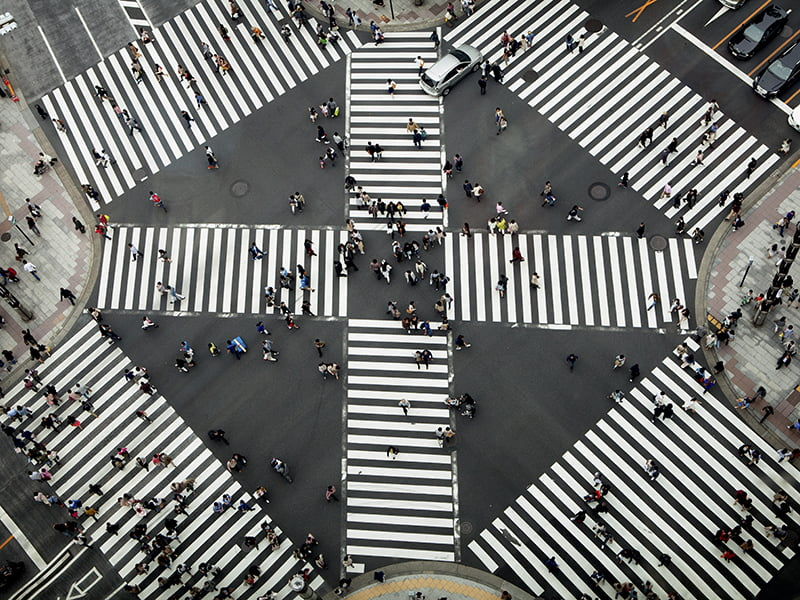 people crossing city connections